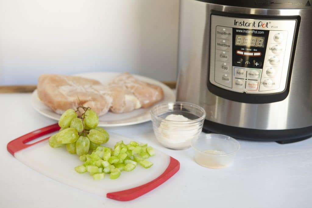 chicken salad ingredients in front of instant pot