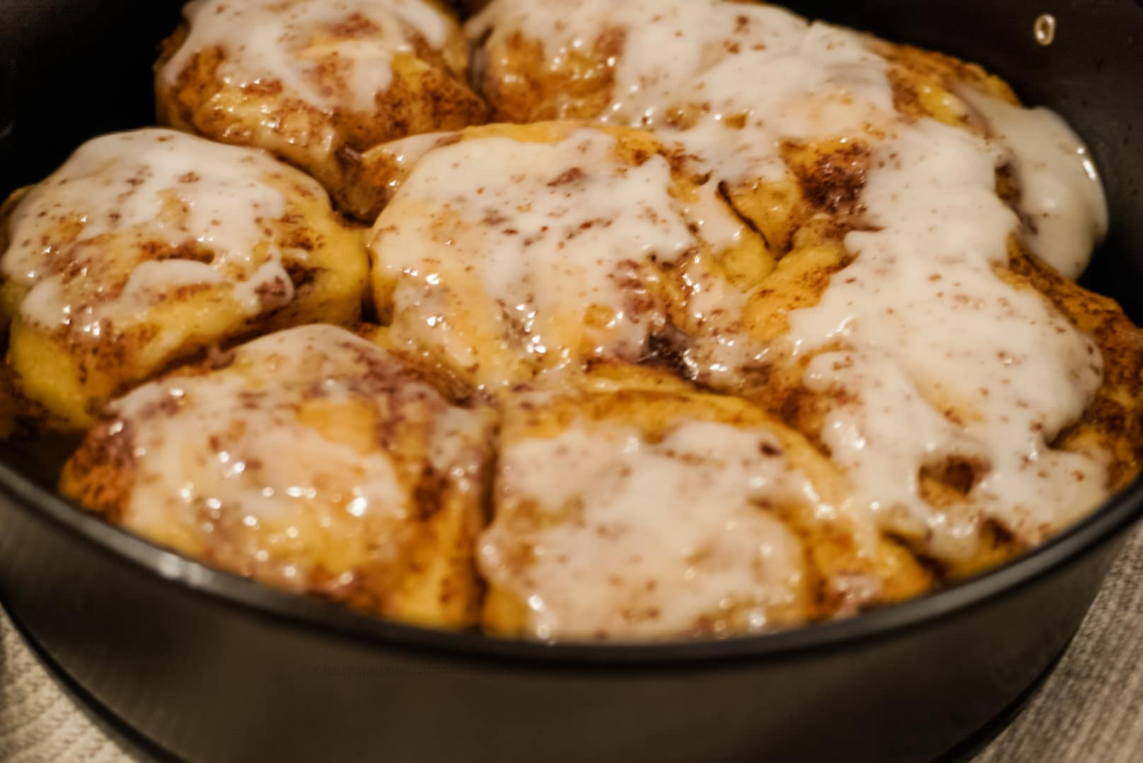 close up of cinnamon rolls with icing