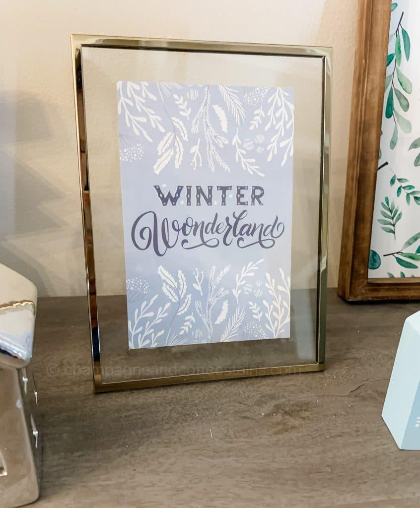 winter wonderland art work in a gold frame