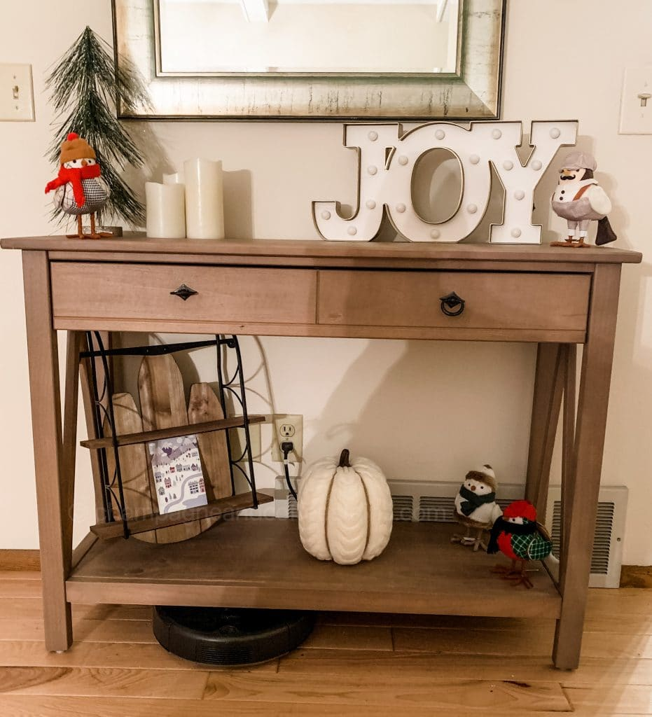 decocrated entryway with sled and joy sign