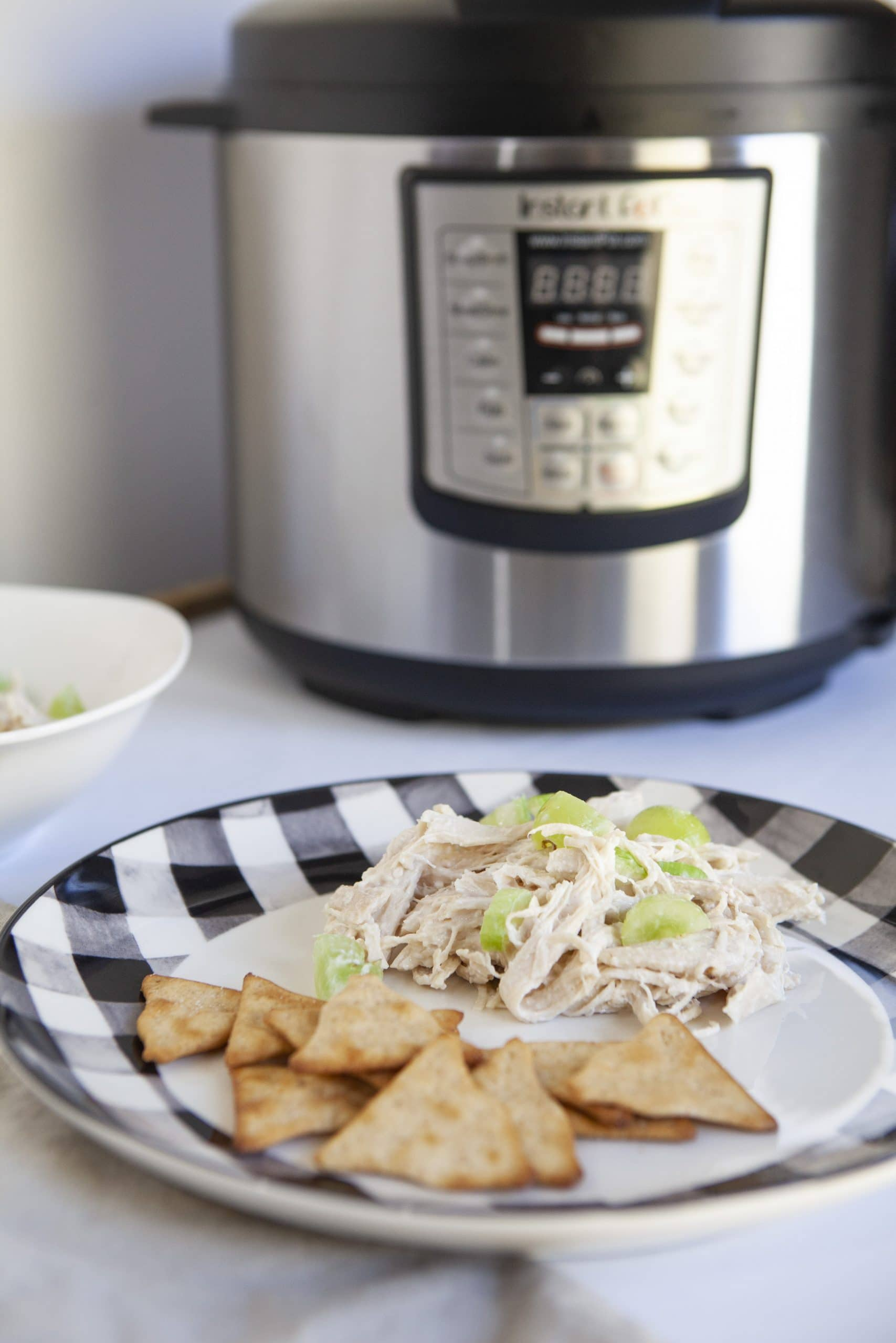 chicken salad in front of the instant pot