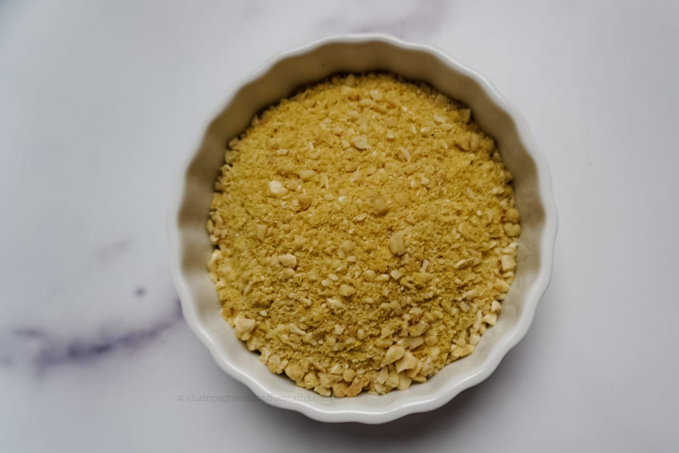 close up of parmesan cheese in a white bowl