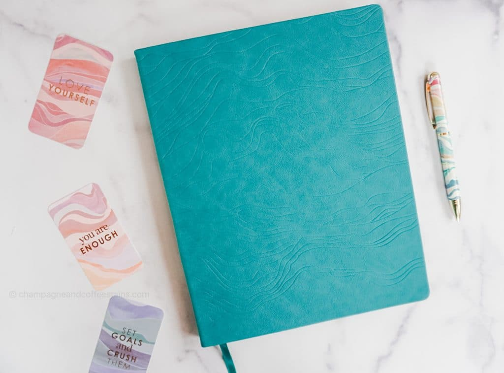 lifeplanner with gratitude cards and a pen