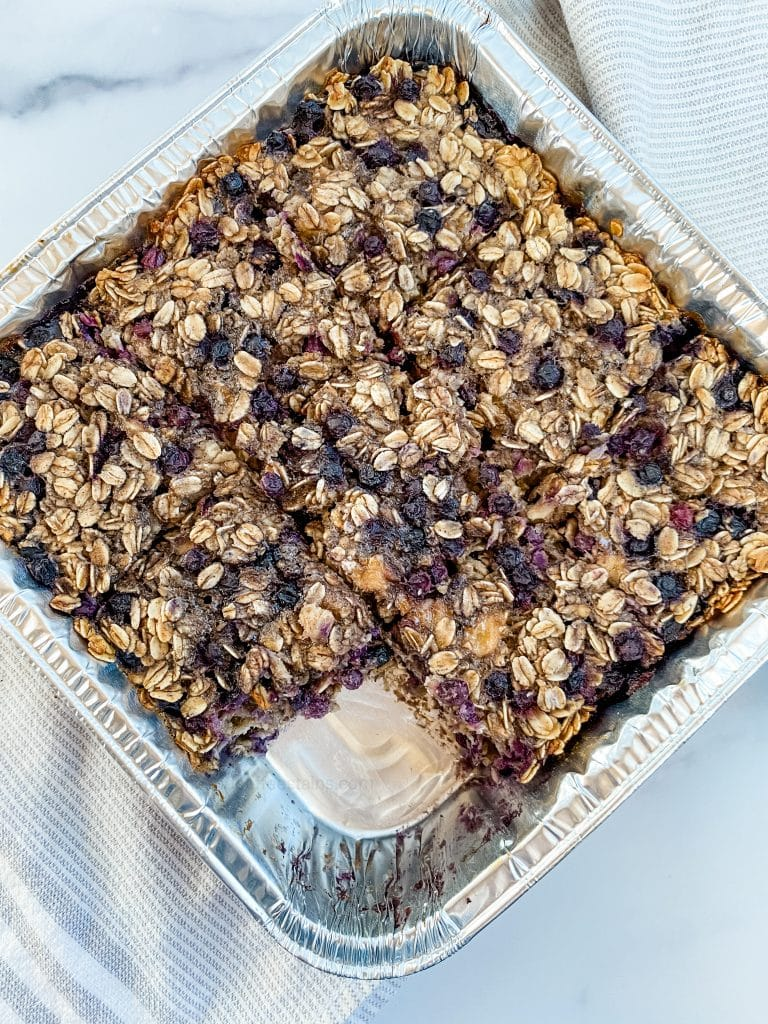 blueberry baked oatmeal in a dish with a slice missing
