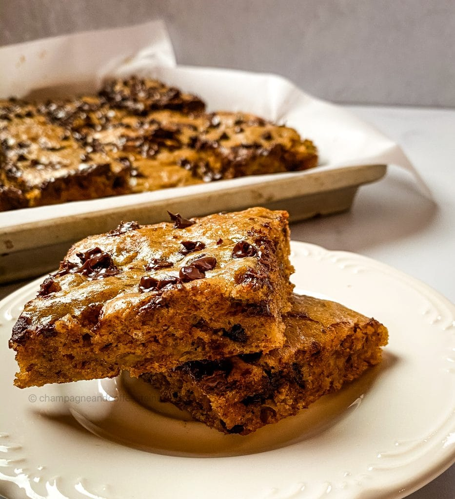 banana chocolate chip bars on a plate with a tray in the background
