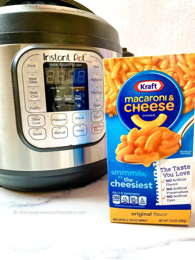 box of kraft macaroni and cheese next to an instant pot