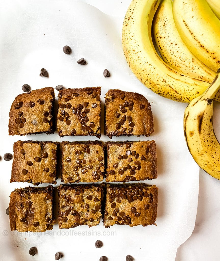 9 brownies on parchment paper with bananas