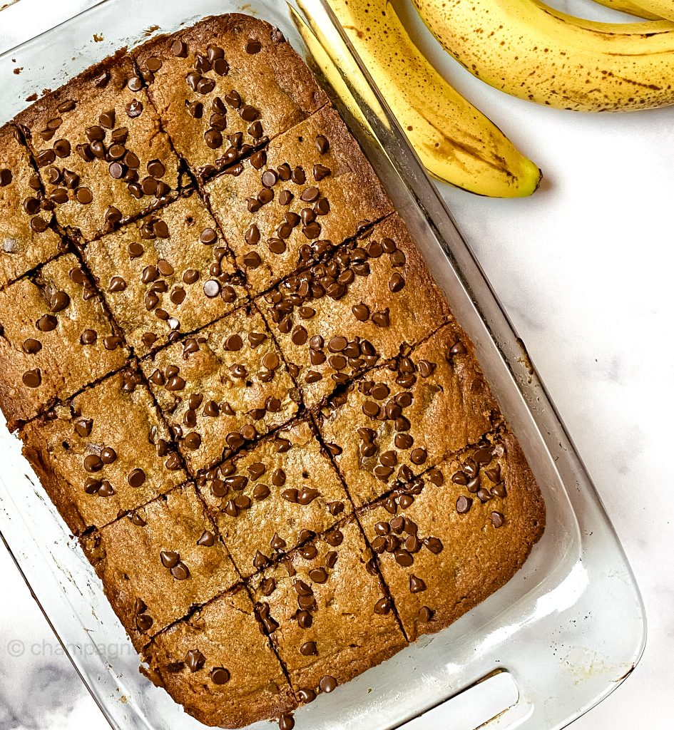 a tray of brownies in a glass baking dish with bananas on the side