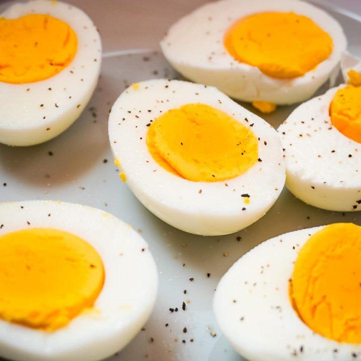 sliced hard boiled eggs on a plate