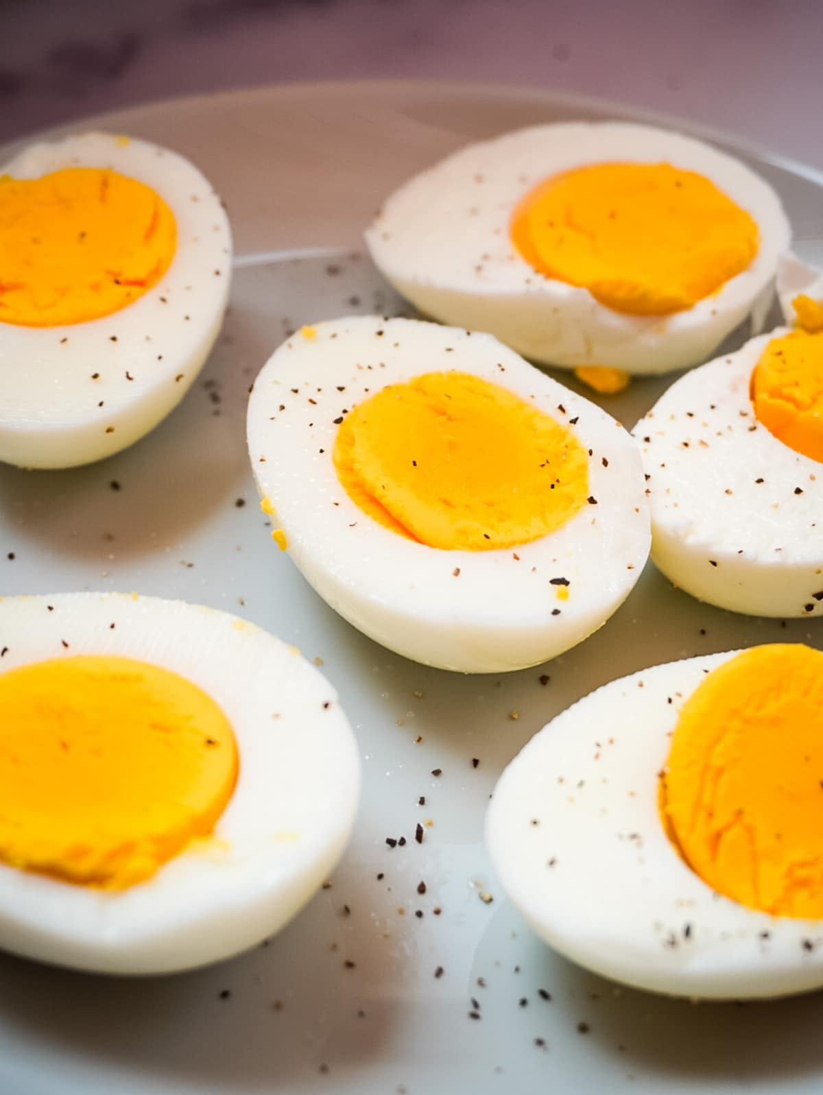 sliced hard boiled eggs on a plate