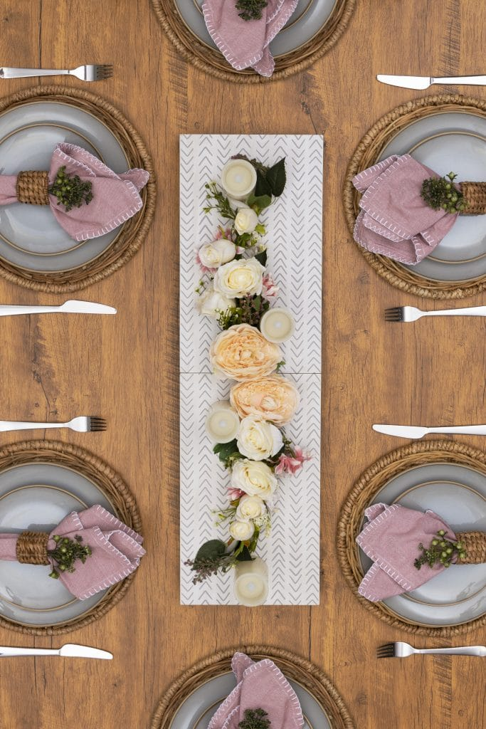 wood runner on a tablescape with flowers
