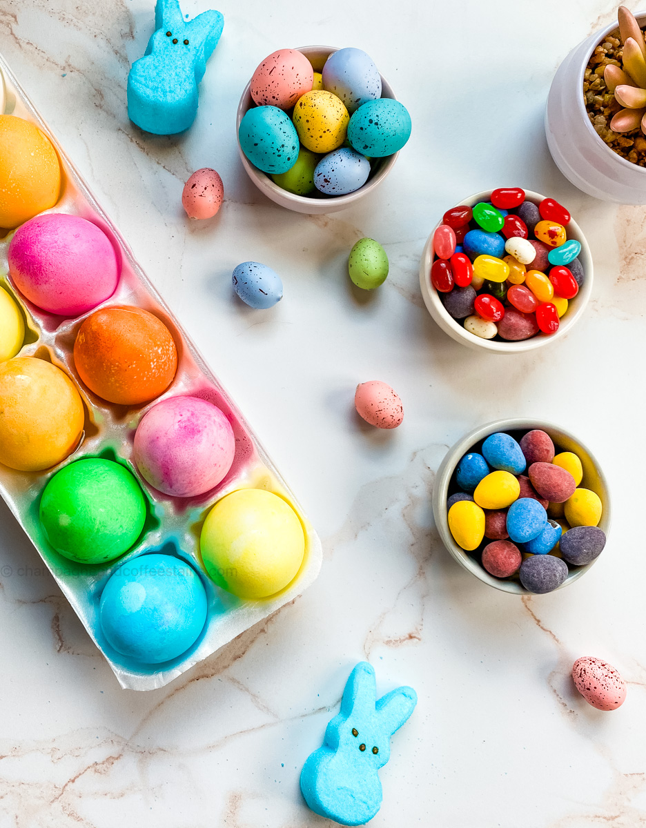 easter eggs in a holder with blue peeps around