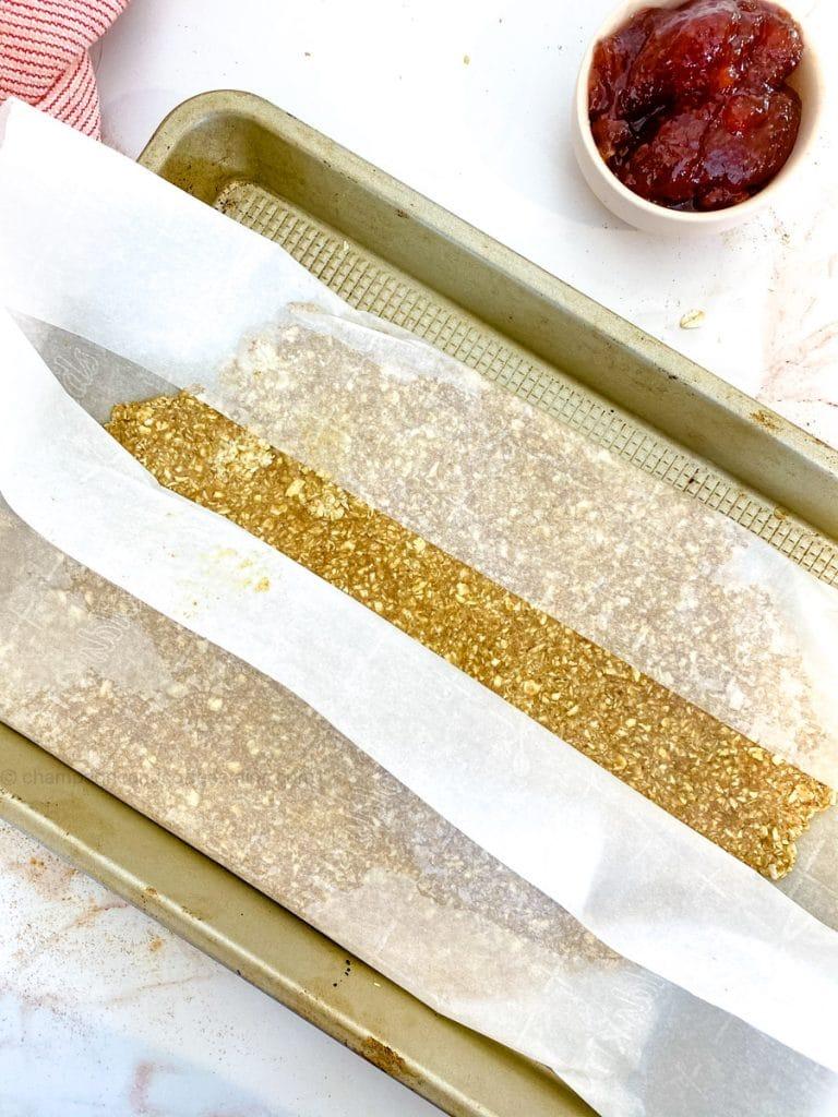 granola dough on a parchment paper