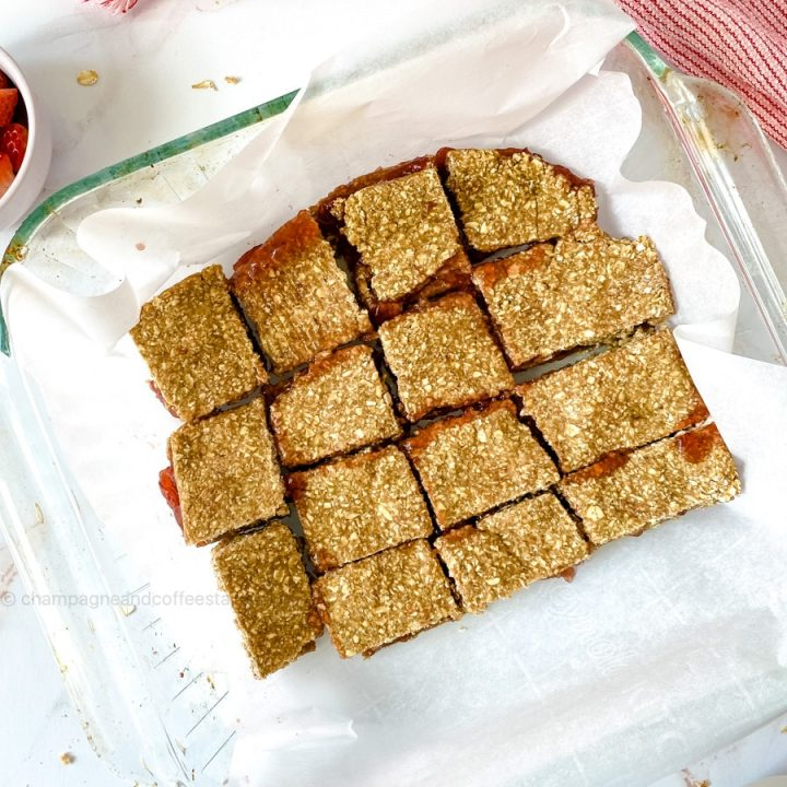 granola bars on parchment paper in a baking dish