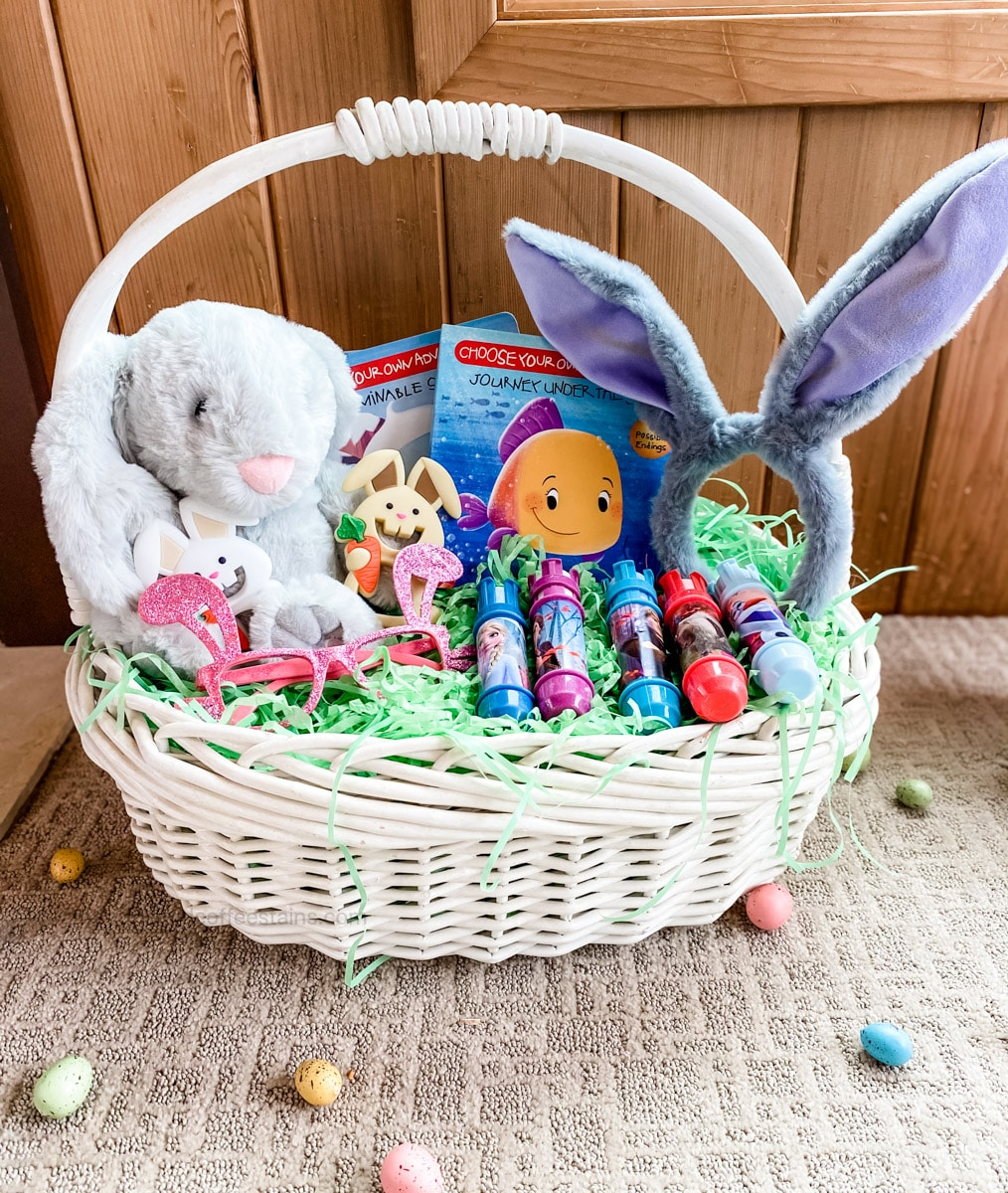 front of a toddler easter basket with easter eggs