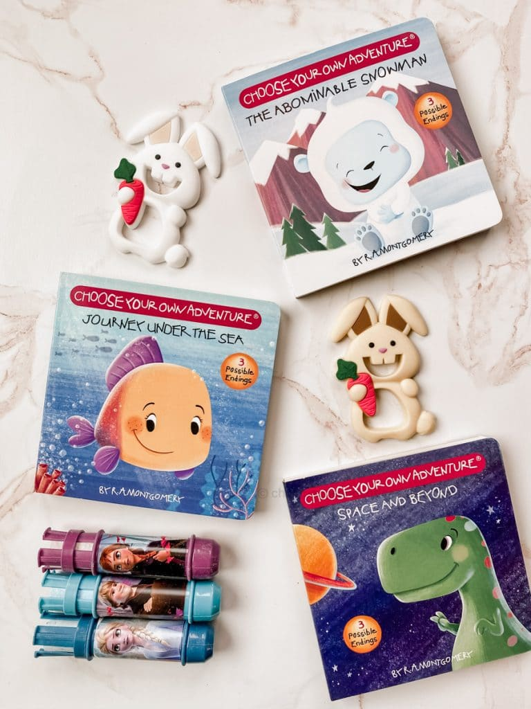 bunny teethers, 3 choose your own adventure books, frozen chalk
