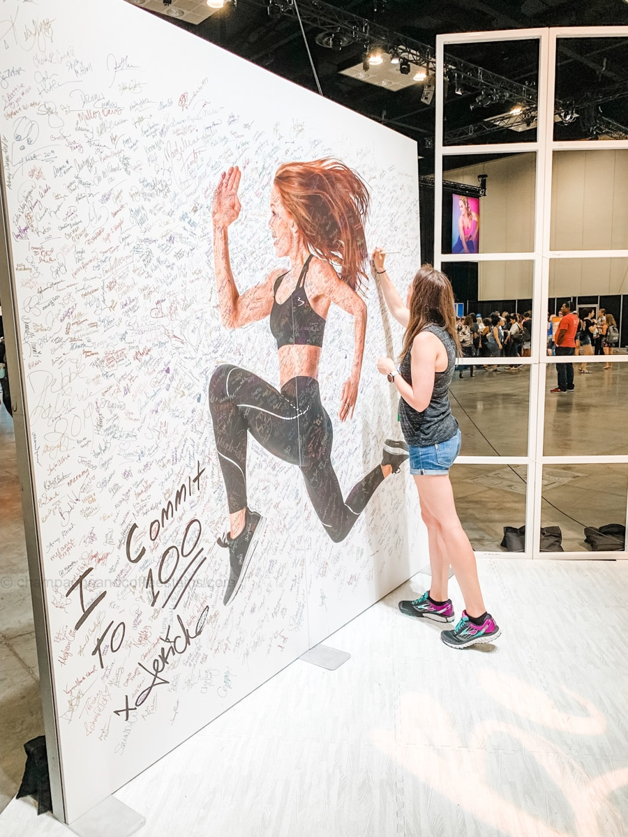 signing the morning meltdown 100 wall at a beachbody conference