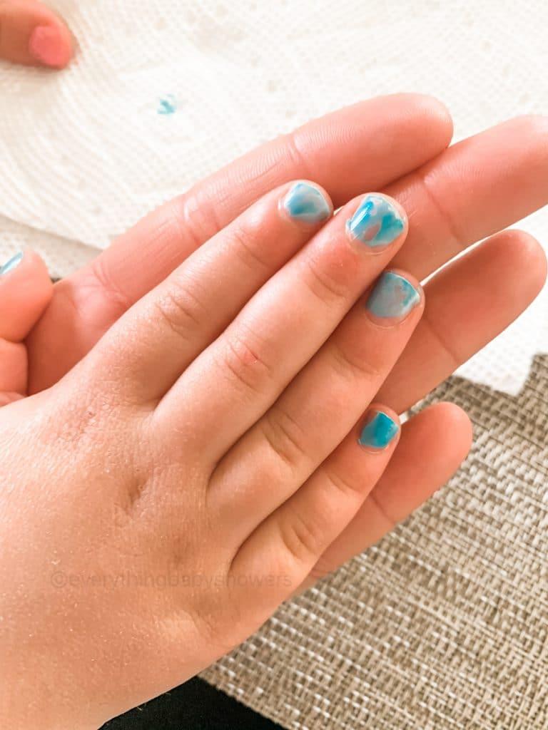 blue piggy paint nail polish on toddler fingers
