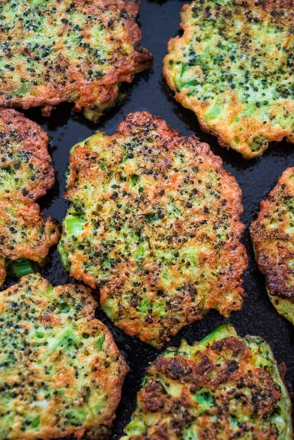 broccoli fritters on a black backdrop