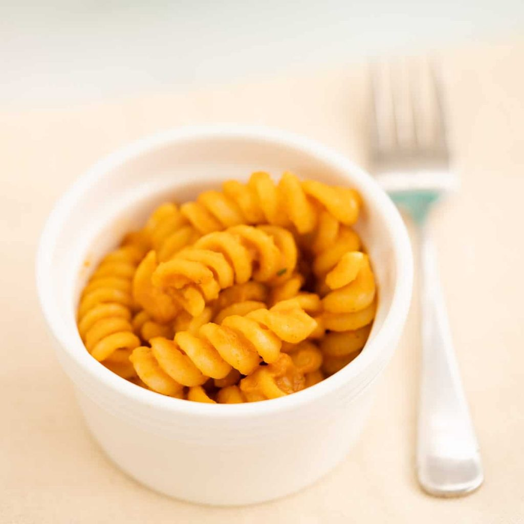 close up of tomato pumpkin pasta in a bowl