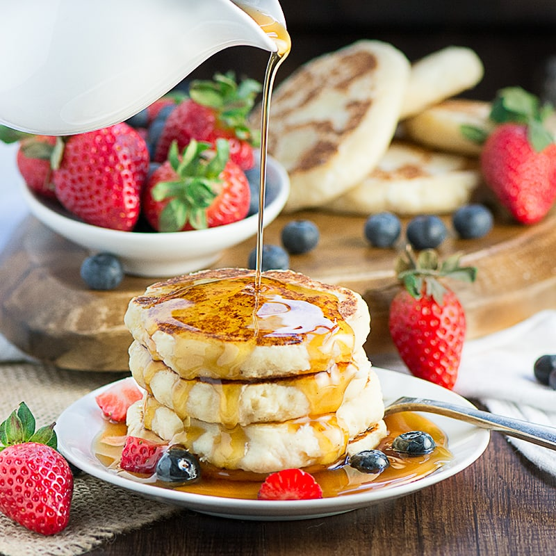 ricotta pancakes with syrup drizzled on top
