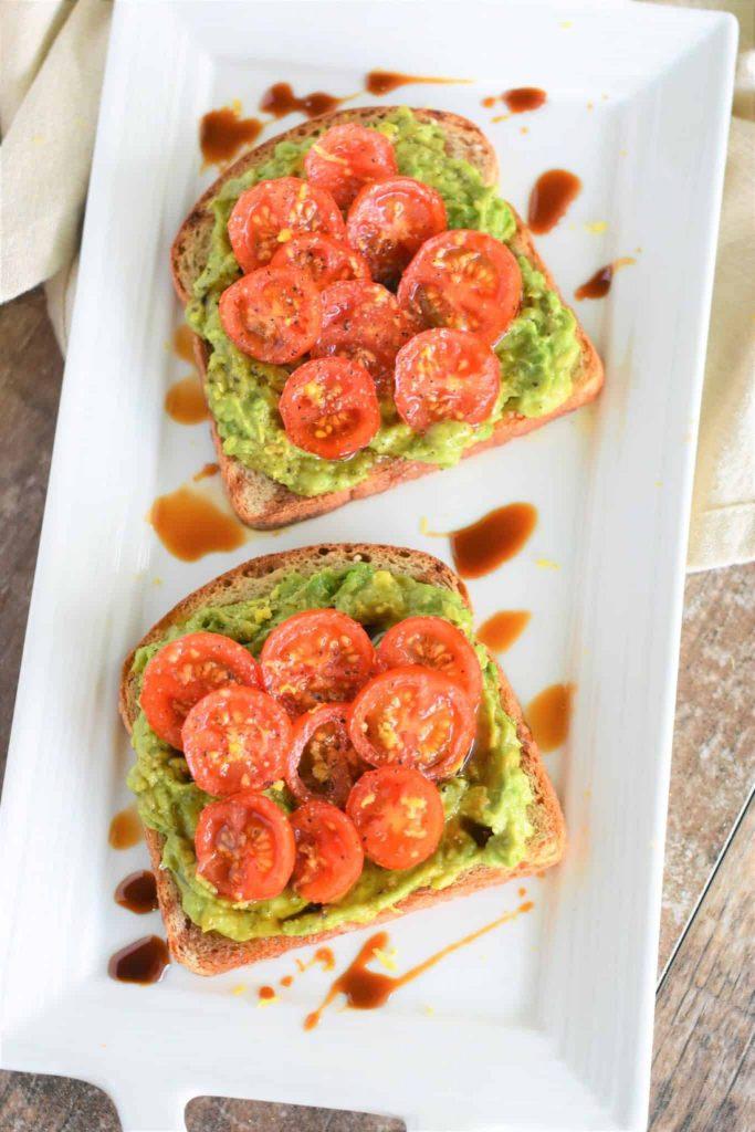 tomato avocado toast on a platter