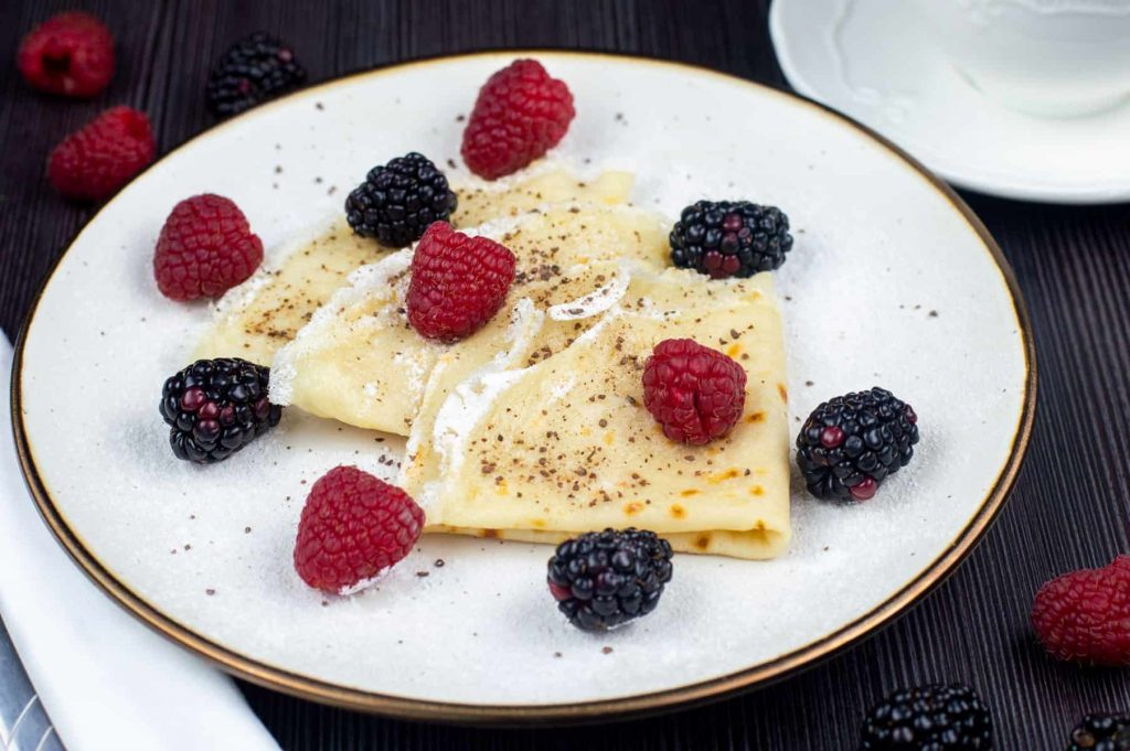 crepes on a plate with berries