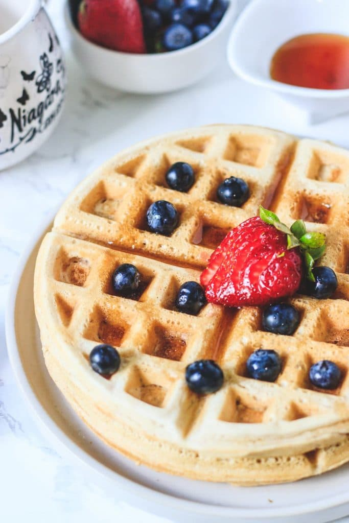 eggless waffle with berries on a plate