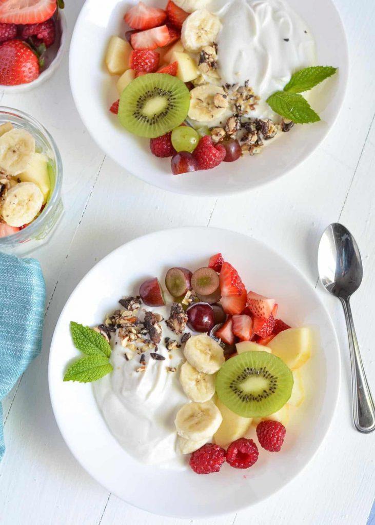 fruit salad with greek yogurt in a bowl