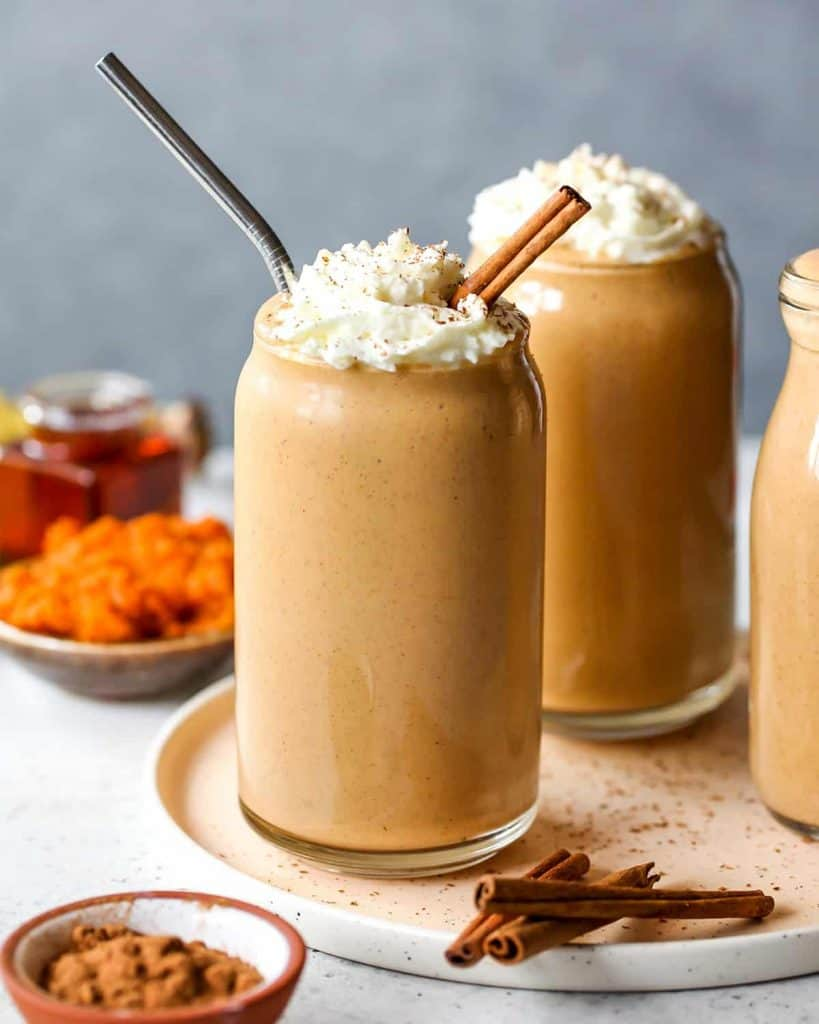 pumpkin smoothies in a glass with cinnamon