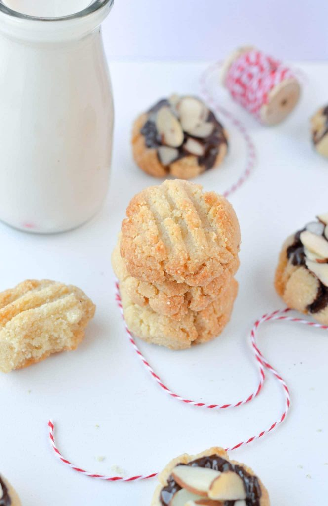 shortbread cookies on a table with milk
