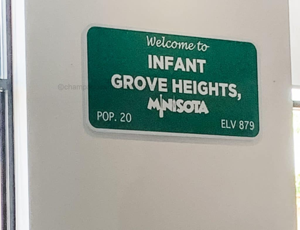 sign that says infant grove heights, minisota