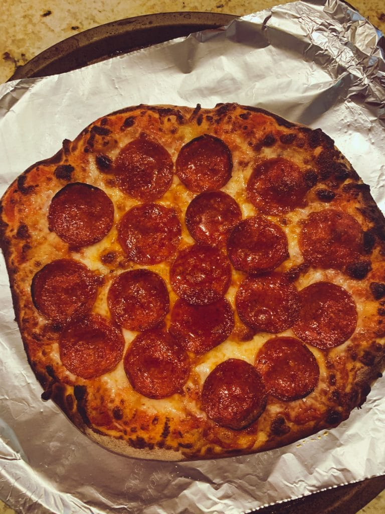 pepperoni pizza made in the ooni pizza oven