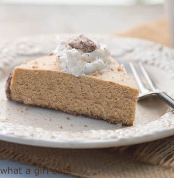slice of pumpkin spice cheesecake with whipped cream